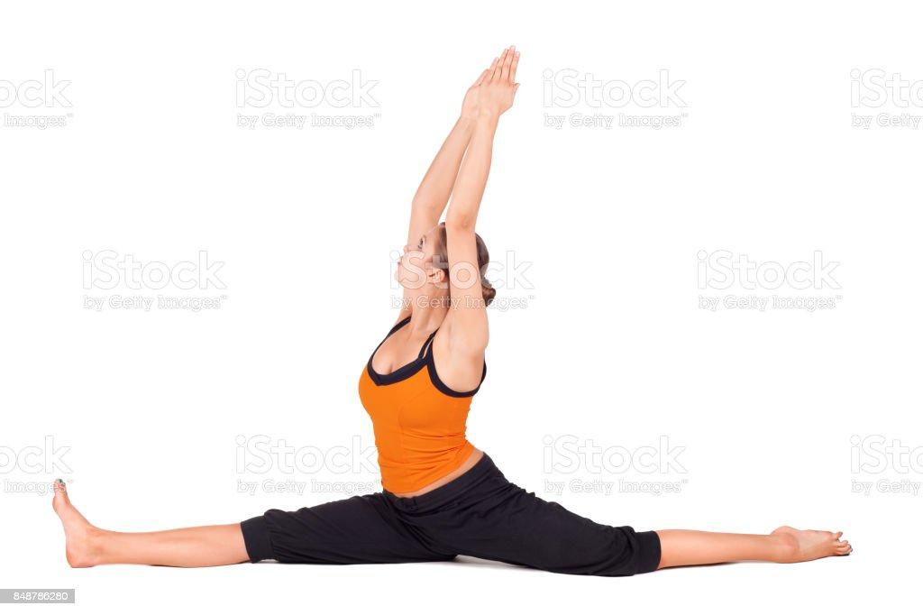 Fit Woman Practicing Monkey God Yoga Pose stock photo