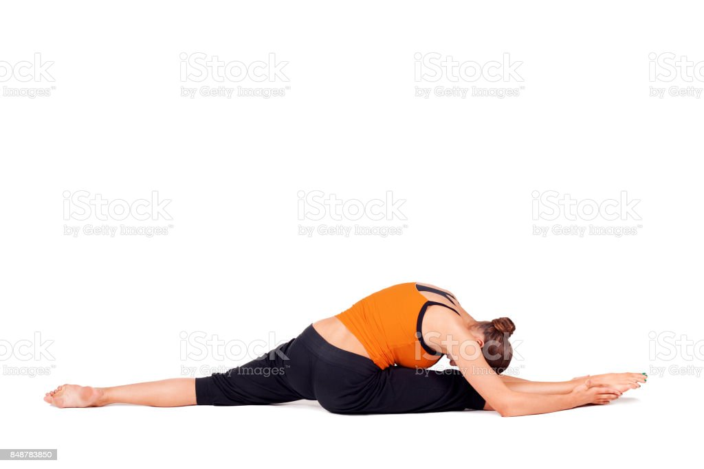 Fit Woman Practicing Yoga Stretching Exercise stock photo