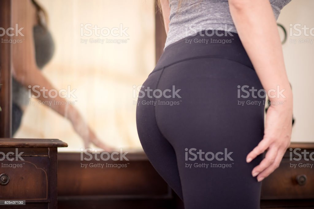 Fit woman ready to go to gym looking in mirror stock photo