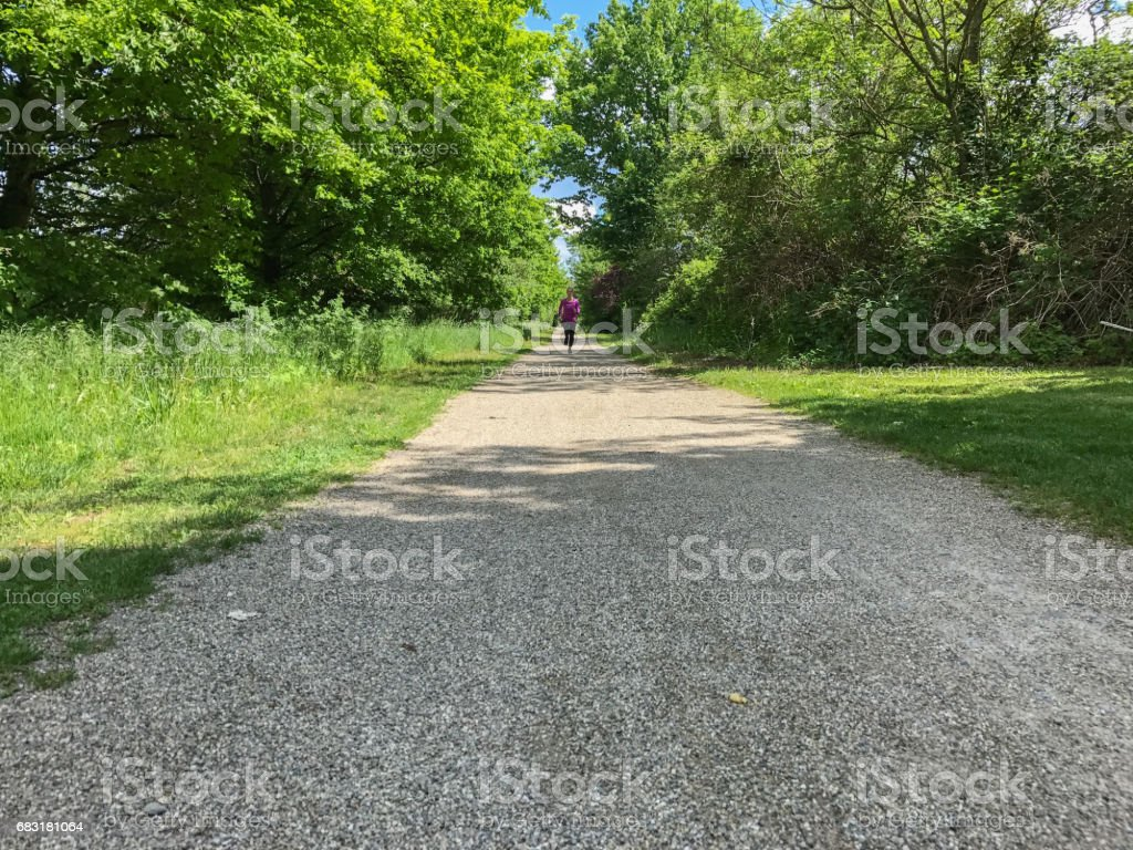 Fit woman running on a country road royalty-free 스톡 사진
