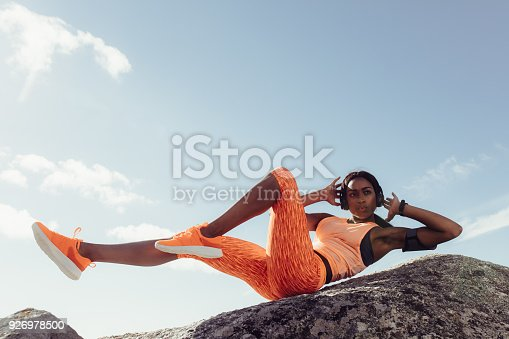 istock Fit woman stretching at the beach 926978500