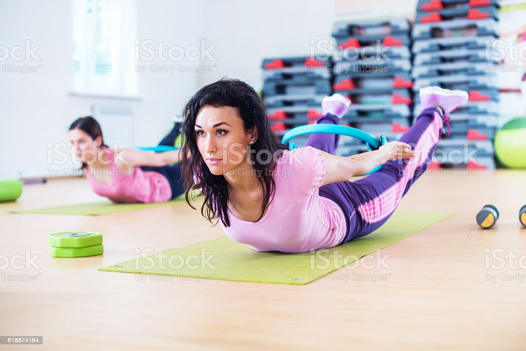 Fit woman stretching training back extension exercise. stock photo