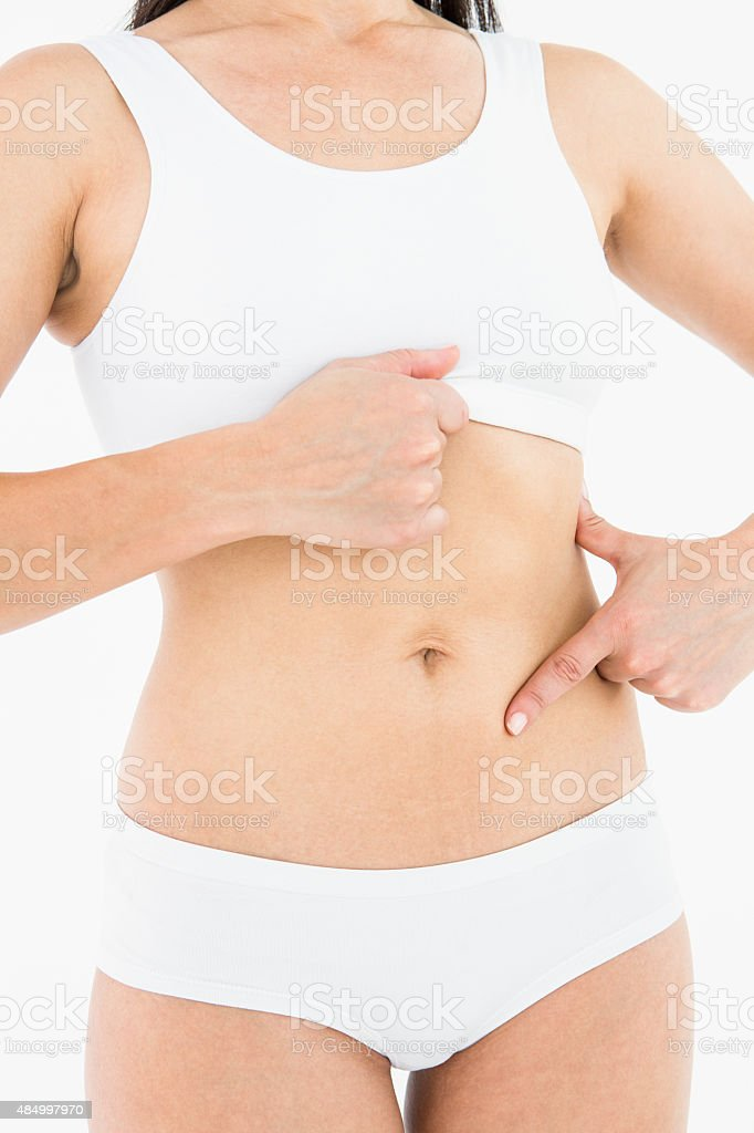 Fit woman touching her painful stomach stock photo