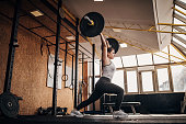 istock Fit woman training with weights in gym 1281363470