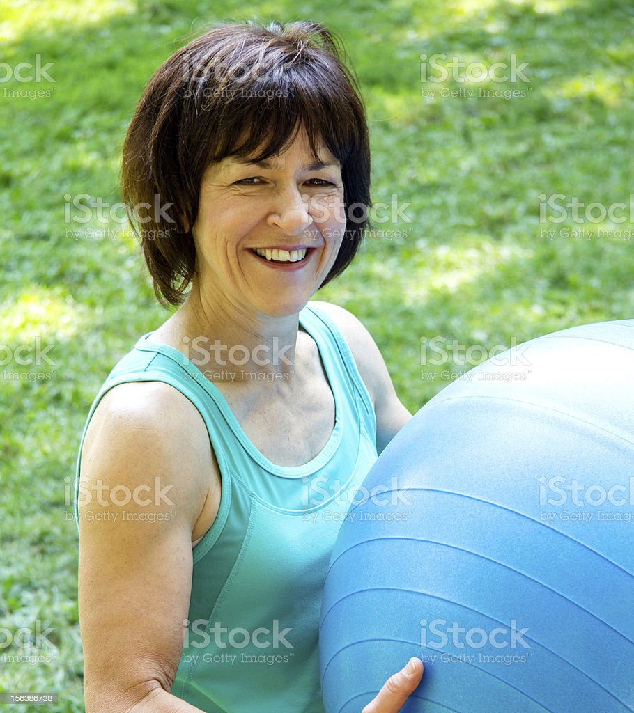 Fit woman with a Pilates ball royalty-free stock photo
