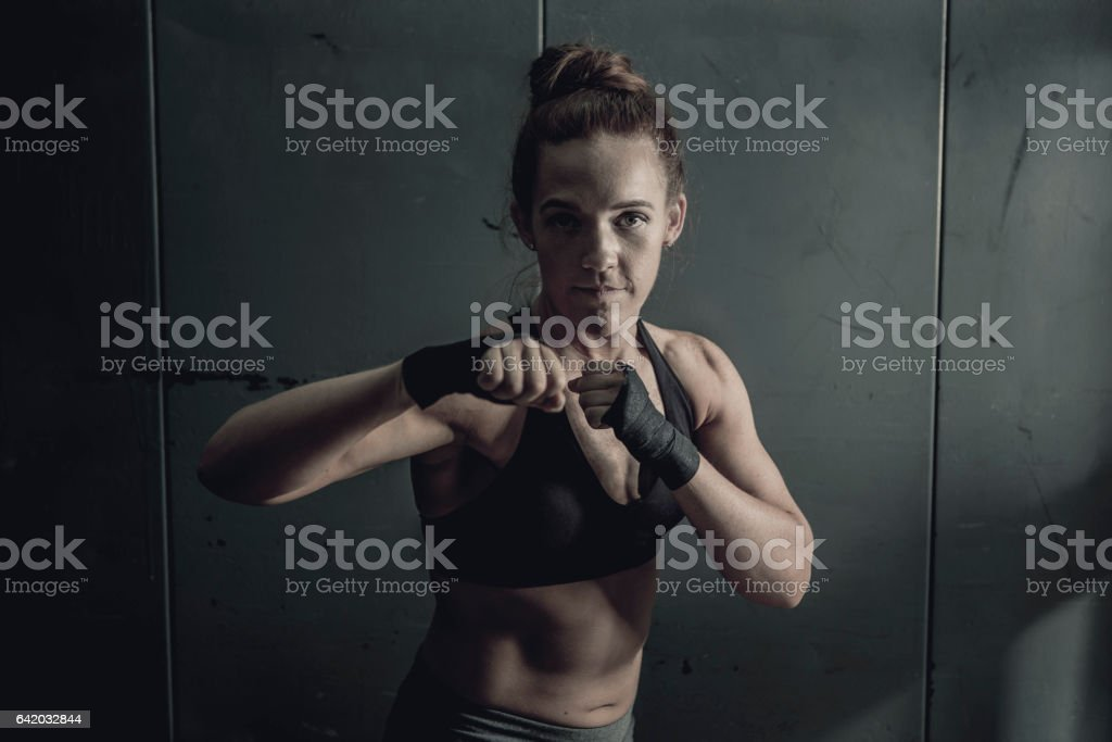 Fit Woman with Fists Raised stock photo