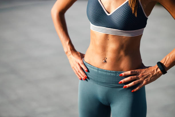 Fit woman with flat stomach and strong muscles stock photo