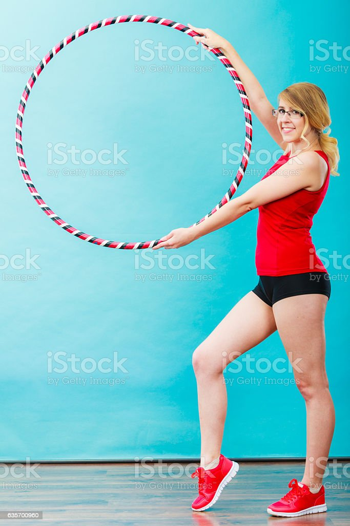 Fit woman with hula hoop doing exercise royalty-free stock photo