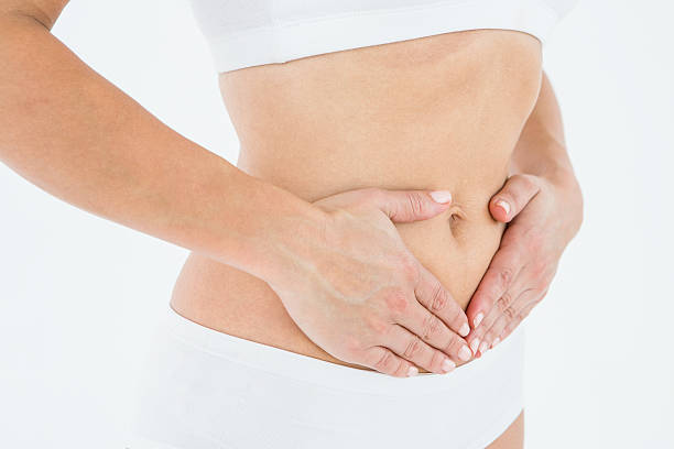 Fit woman with stomach pain stock photo