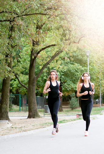 Fit Women Jogging Outdoors And Living A Healthy Lifestyle Stock Photo Download Image Now Istock Coofandy men's fitted workout shorts bodybuilding sporting running training jogger gym short pants with pockets. 2