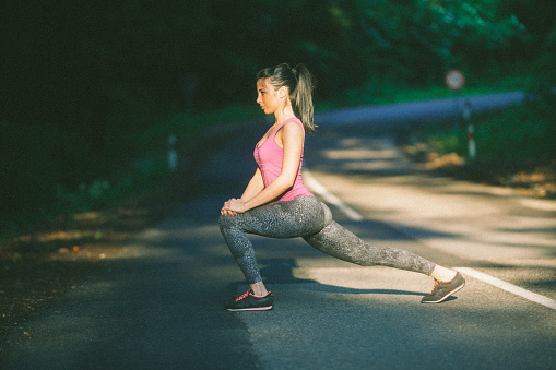 Fit Women Stretching On The Road Stock Photo Download Image Now Istock See more ideas about fit women, fitness inspiration, fitness girls. https www istockphoto com photo fit women stretching on the road gm872239068 243640570