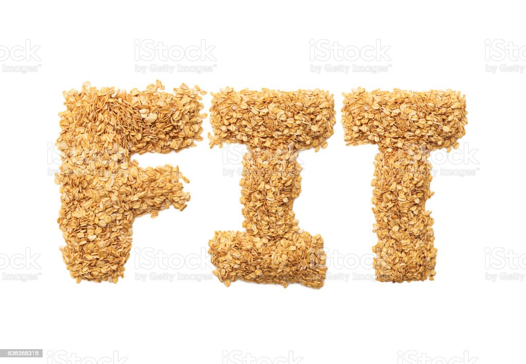 'Fit' written with oat grains word. Shape of oatmeal flakes on isolated white background stock photo
