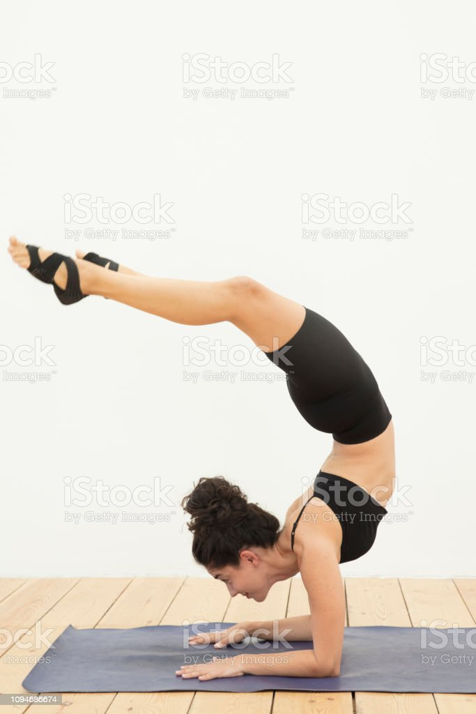Fit Yogini Woman Yoga Poses On The Wooden Floor Stock Photo Download Image Now Istock