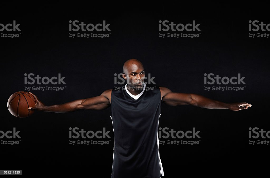 Fit young basketball player with arms outstretched stock photo