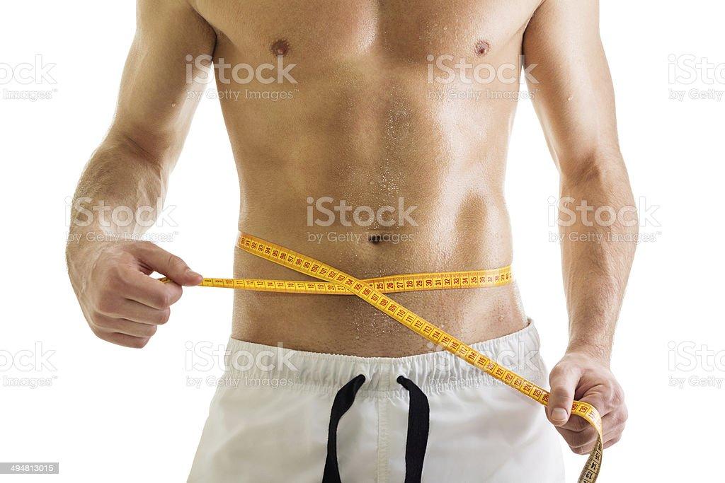 Fit young bodybuilder hombre medir su cintura - Foto de stock de Abdomen libre de derechos