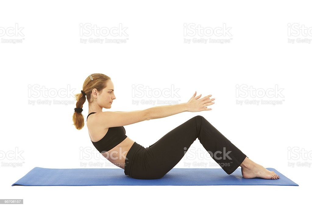 Fit young brunette pilates instructor royalty-free stock photo
