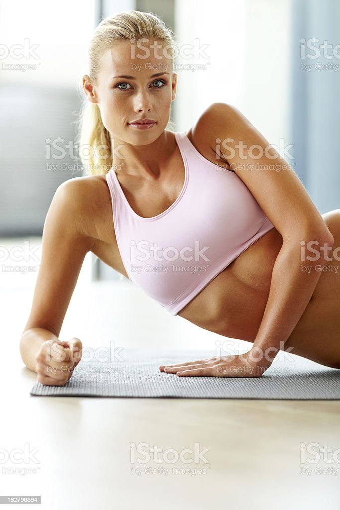 Fit young female lying on exercise mat royalty-free stock photo