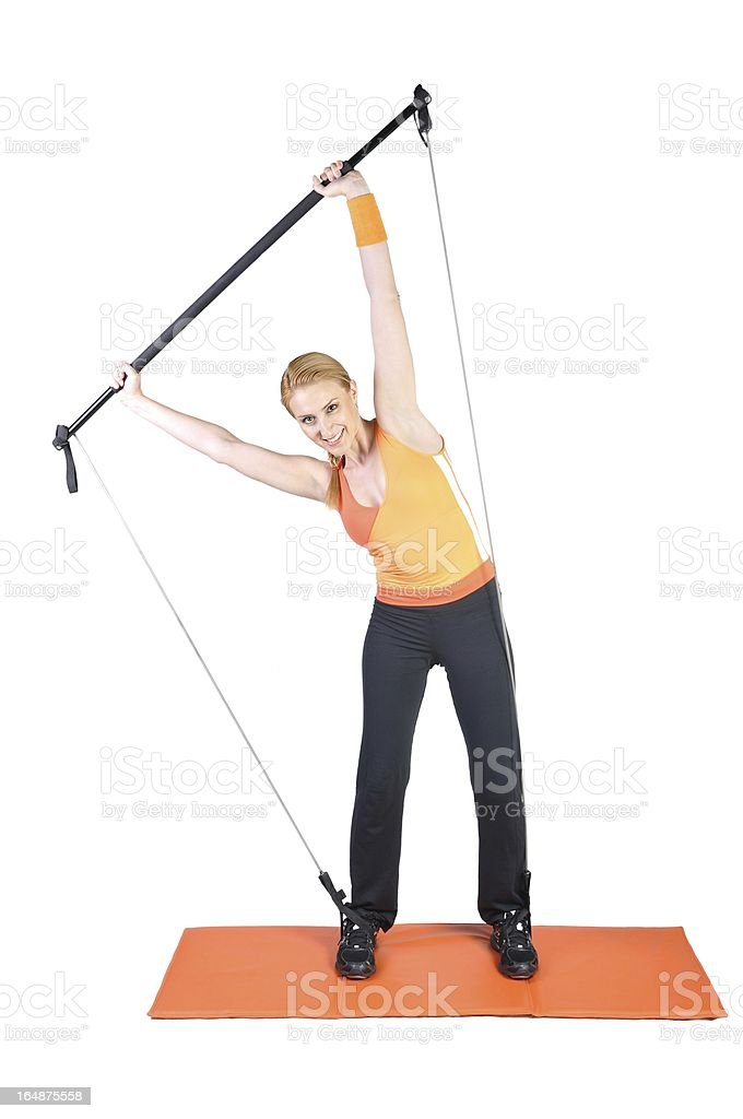 Fit young female pilates instructor showing different exercises royalty-free stock photo