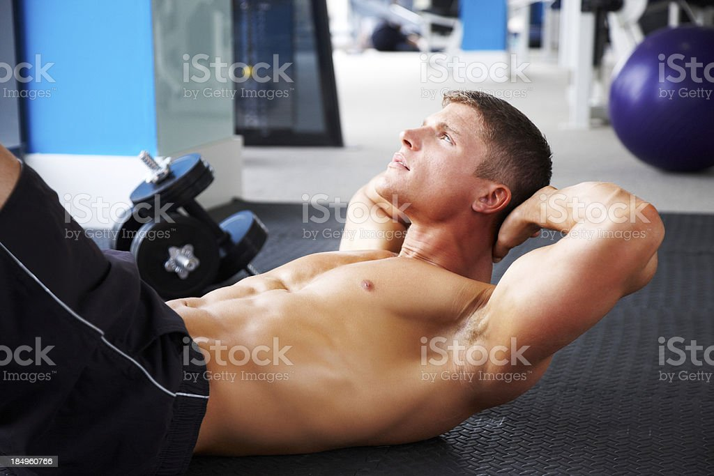 Fit Young Man Doing Crunches royalty-free stock photo