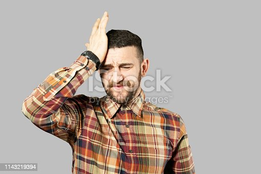 istock Fit young man posing over grey background. 1143219394