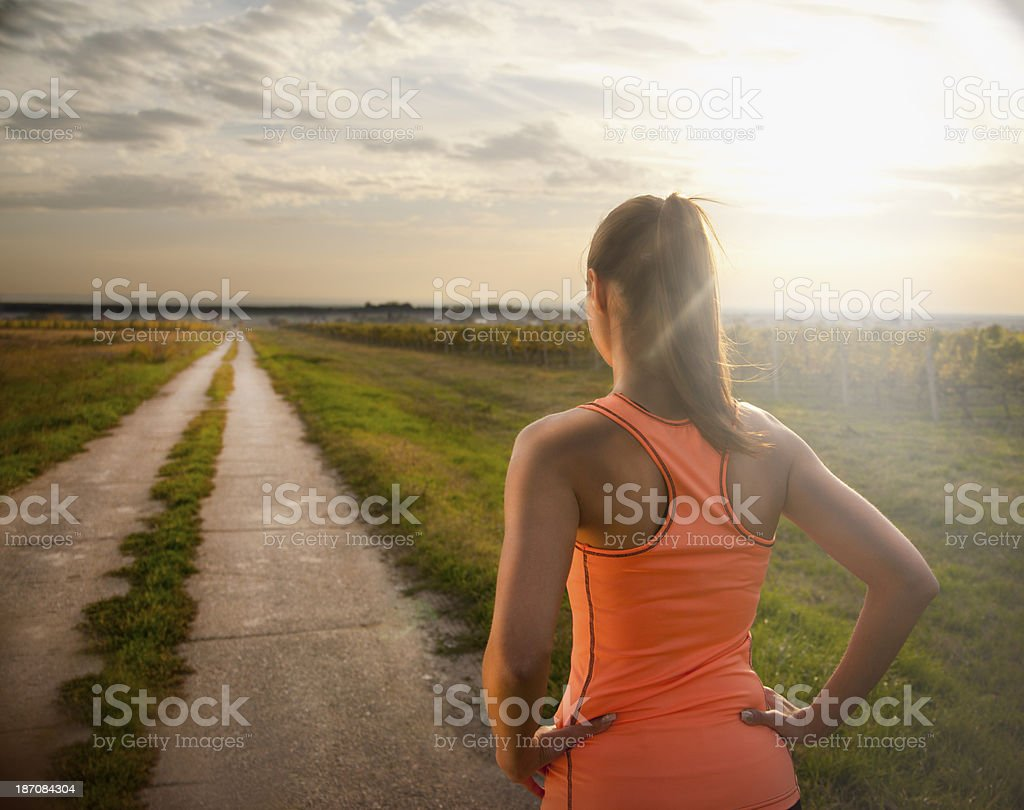 Fit young woman catching her breath during training stock photo