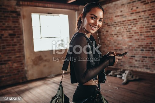istock Fit young woman coming to gym for workout 1051320132