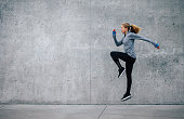 istock Fit young woman doing cardio interval training 629588986