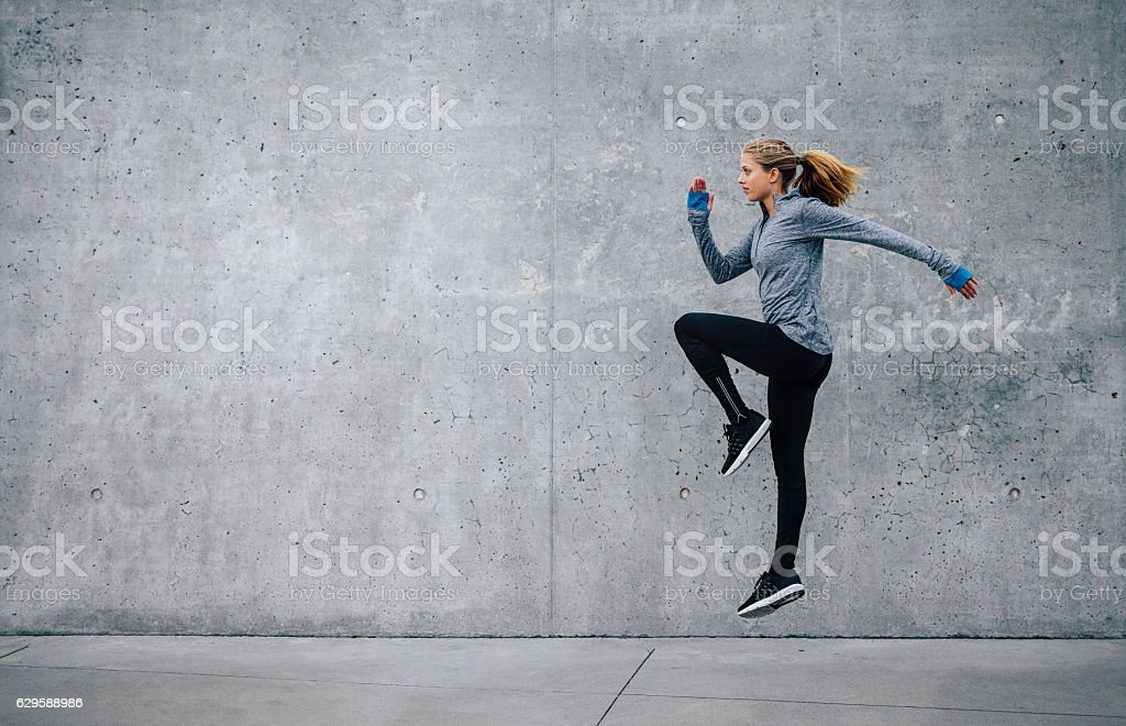 Fit young woman doing cardio interval training stock photo