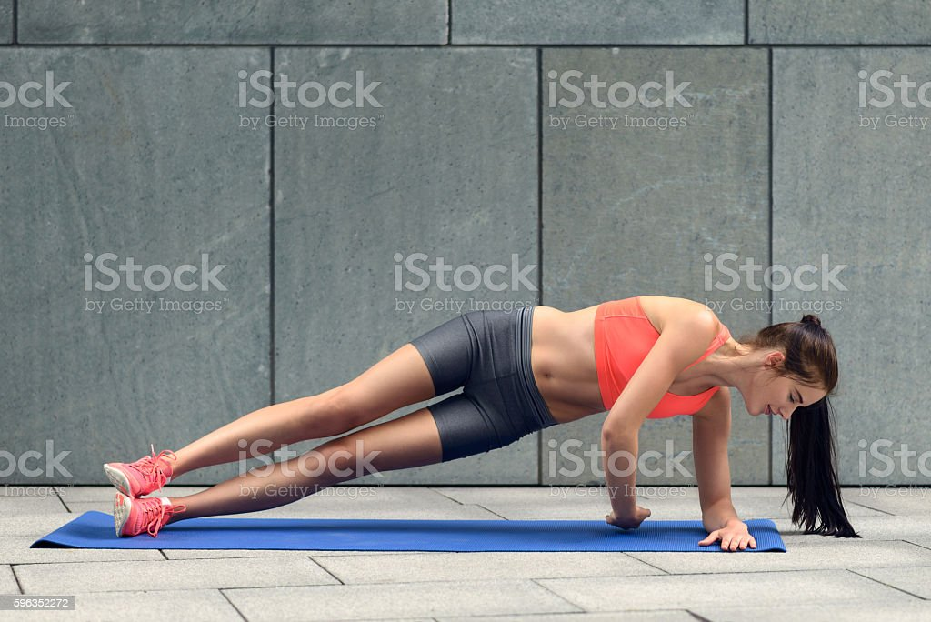 Fit young woman doing planks royalty-free stock photo