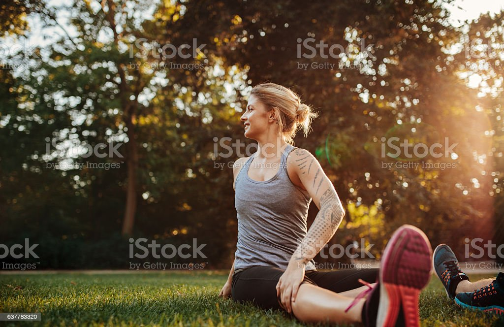 Fit young woman doing stretching workout stock photo