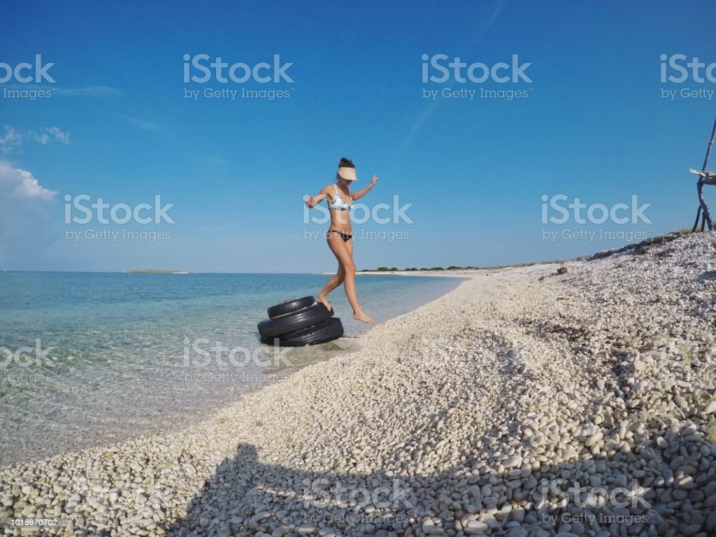 Fit young woman enjoying the beach view/ flat tire / Adriatic sea stock photo