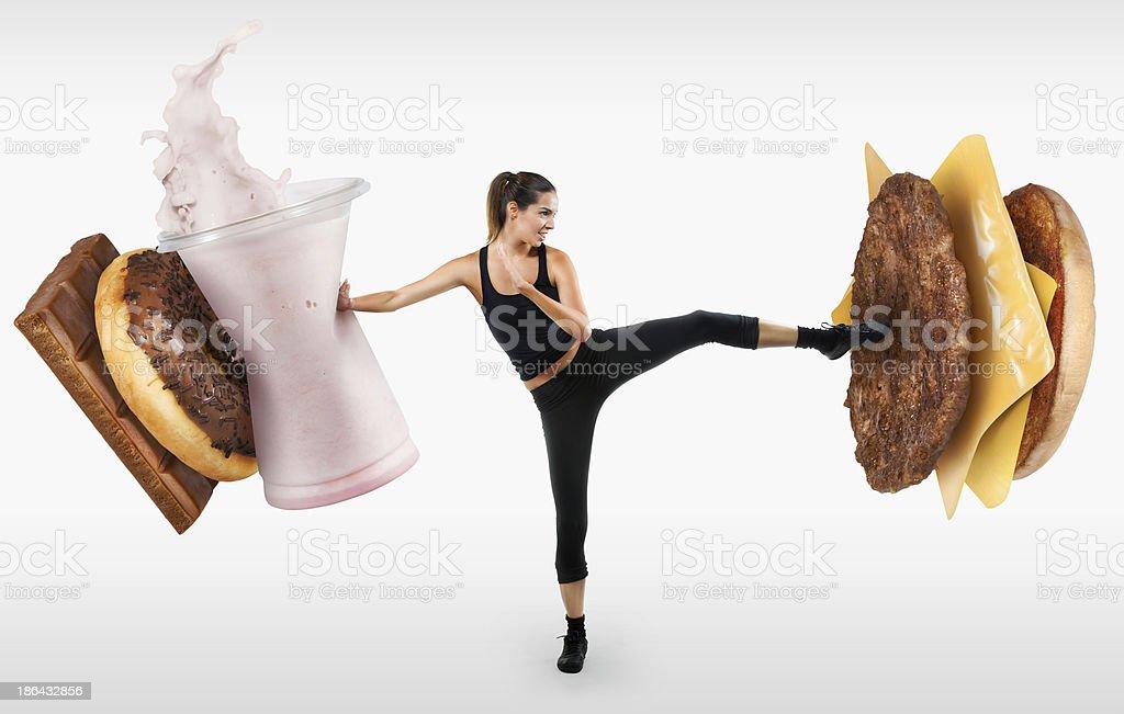 Fit mujer joven luchando de comida rápida - Foto de stock de Adolescente libre de derechos