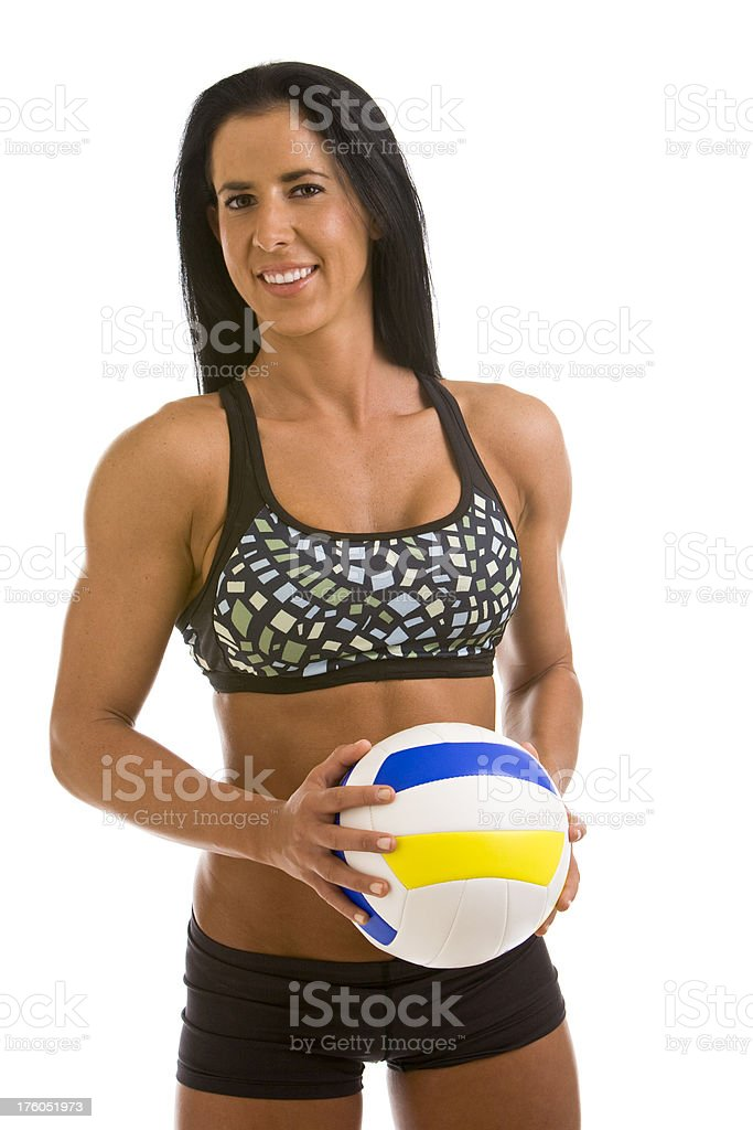 Fit young woman holding a volleyball royalty-free stock photo