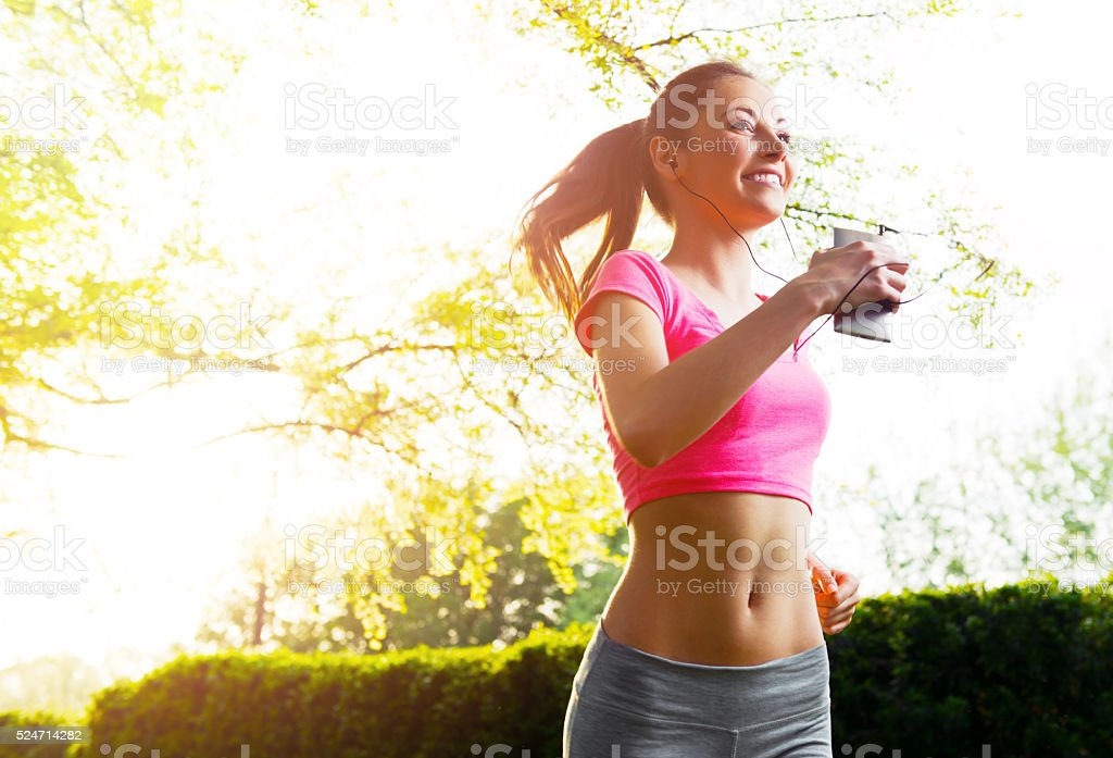 Fit young woman running  outdoors, healthy lifestyle royalty-free stock photo