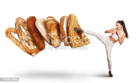 Fit young woman saying NO to unhealthy carbohydrates