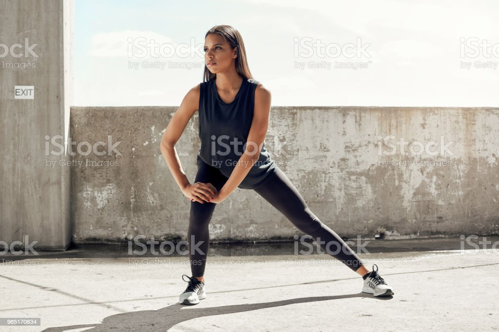 Fit young woman stretching royalty-free stock photo