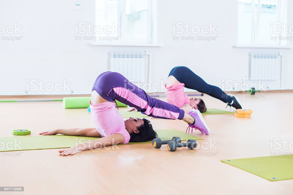 Fit young women stretching body in the fitness studio. stock photo