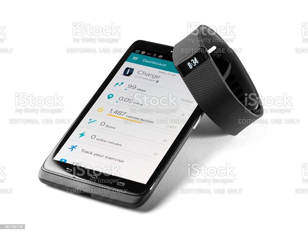 Fitbit charge with smartphone app stock photo