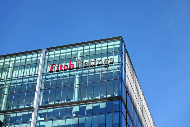 Fitch Ratings logo signage at top of their Headquarters in UK stock photo