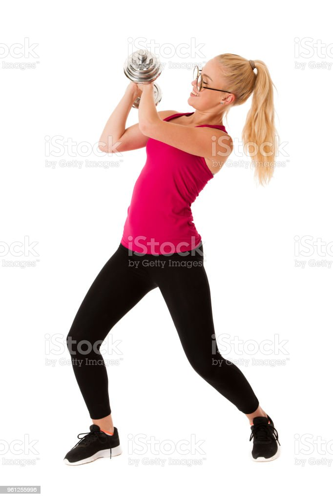 Fitnes - Blonde young woman working out with dumbbells isolated over white stock photo
