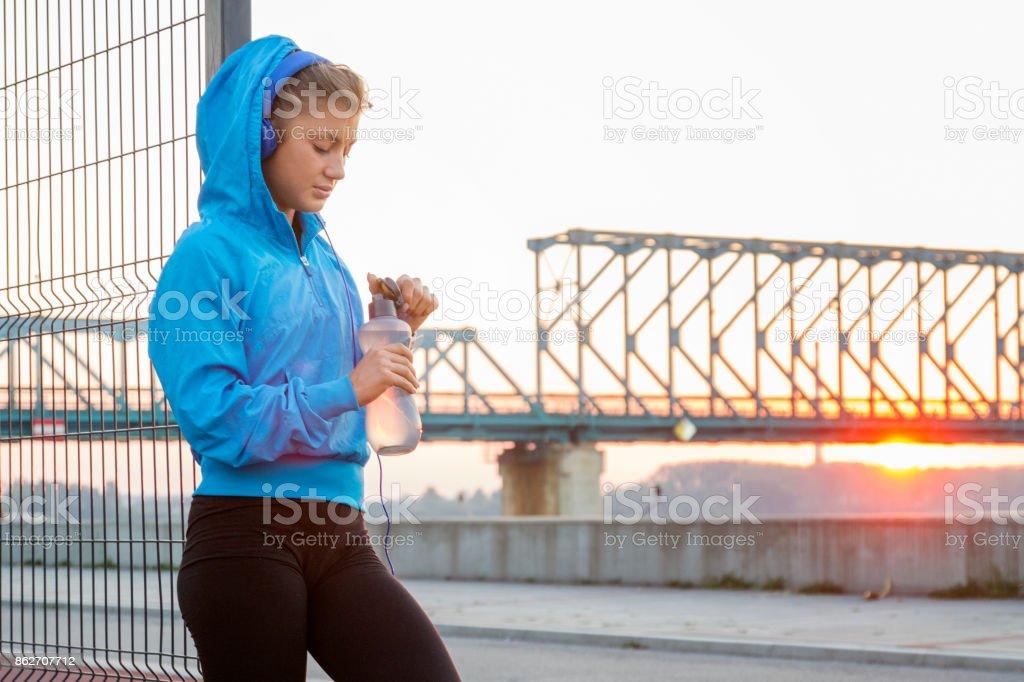 Fitnes girl taking break stock photo