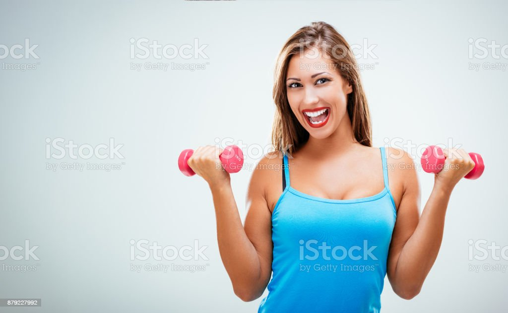 Fitnes Woman With Dumbbells stock photo
