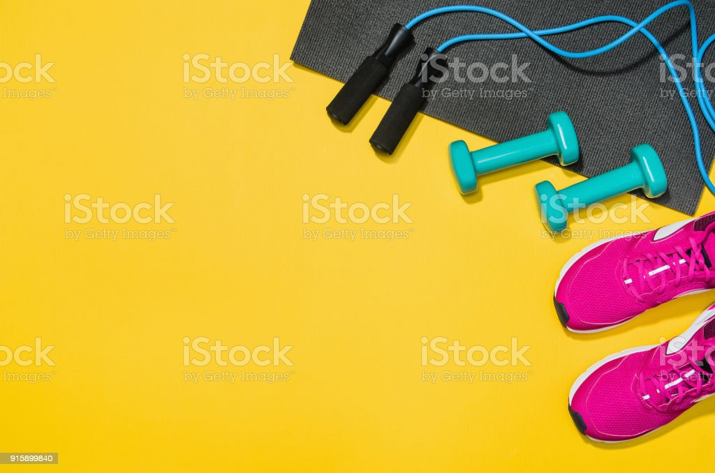 Fitness accessories on yellow background mock up, top view royalty-free stock photo