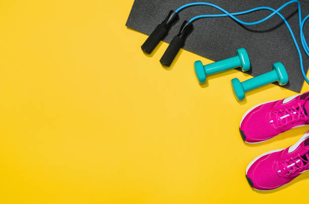 fitness accessories on yellow background mock up, top view - group of objects stock pictures, royalty-free photos & images