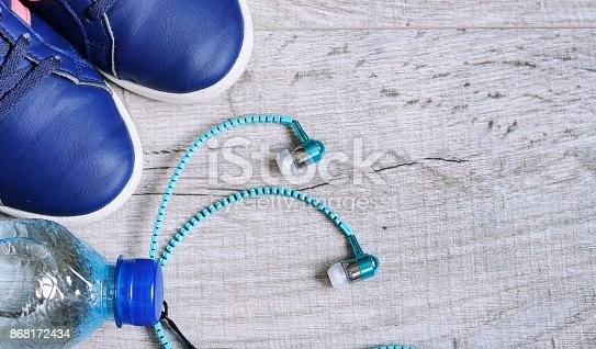 616251000 istock photo Fitness accessories. Sports dumbbells sneakers sports shoes and 868172434