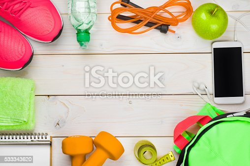 istock Fitness and weight loss concept on wooden planks background 533343620