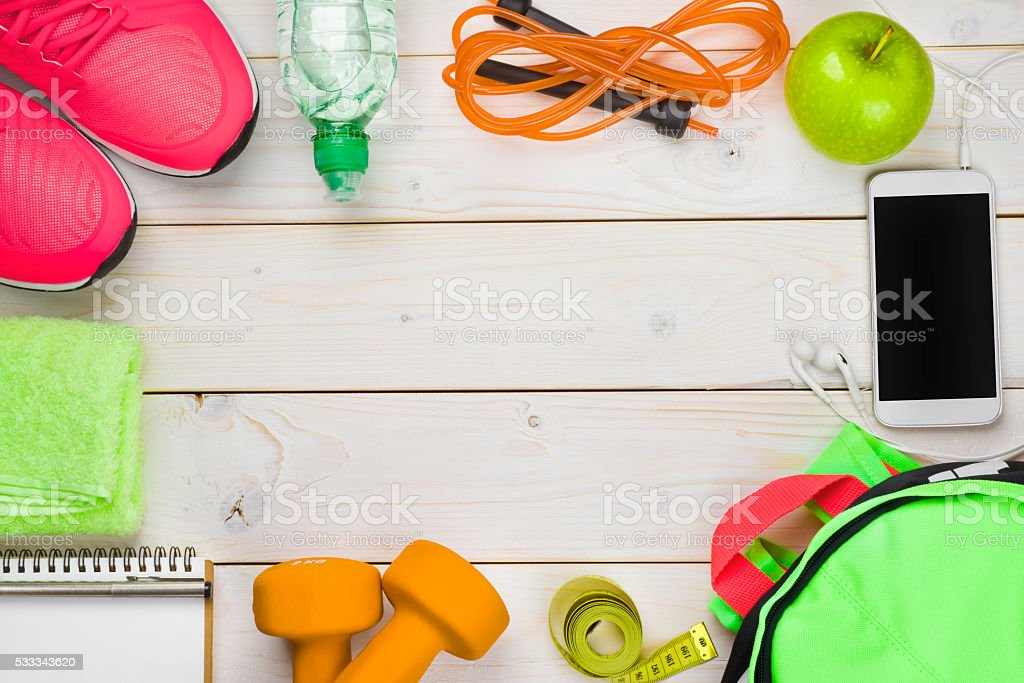 Fitness and weight loss concept on wooden planks background stock photo