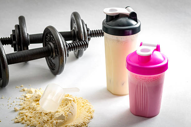 fitness and workout concept - protein stock photos and pictures
