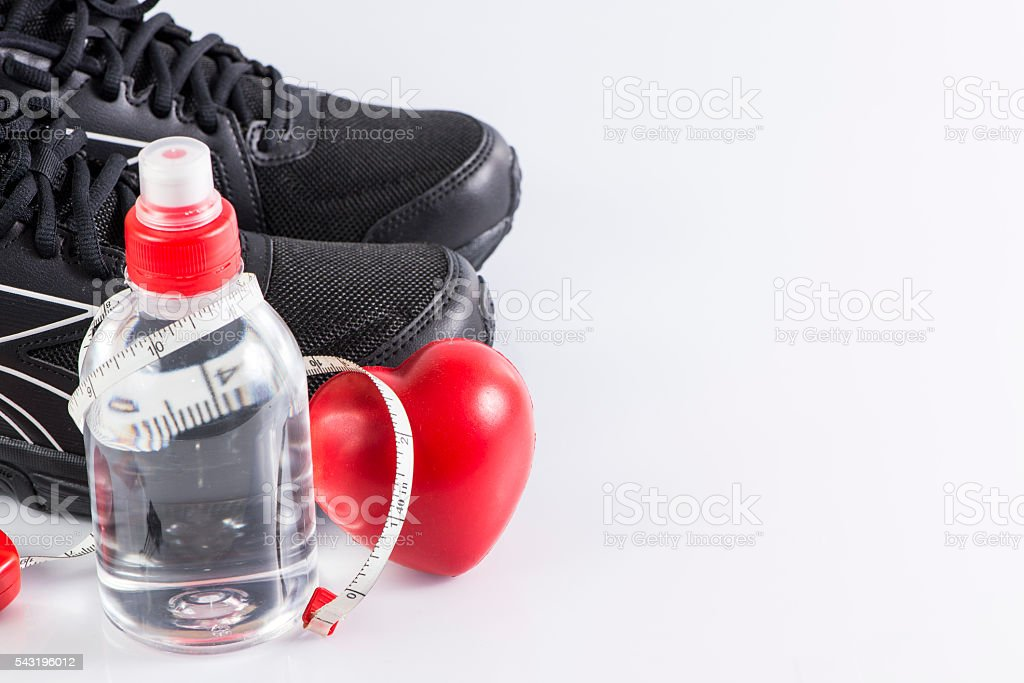 Fitness background with bottle of water , shoes and heart stock photo