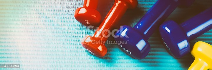 istock Fitness background with colorful dumbbells. Healthy lifestyle concept 641196394